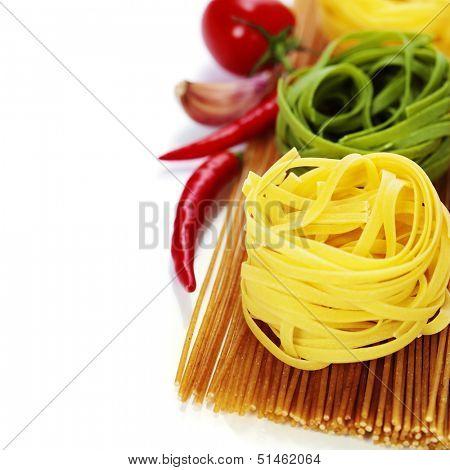 whole wheat spaghetti and egg pasta nests over white
