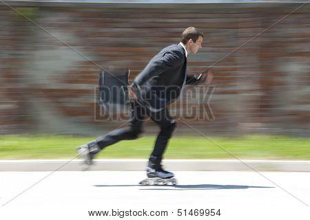 Businessman rollerblading, blurred motion. Concept: go green