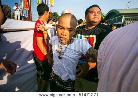 NAKHON CHAI, THAILAND - MAR 23: Unidentified participant Master Day Ceremony able Khong Khuen - spirit possession during the Wai Kroo at Wat Bang Pra monastery on Mar 23, 2013 in Nakhon Chai, Thailand