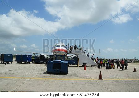 Passengers disembarking American Airlines plane landed at Philip Goldson Airport in Belize
