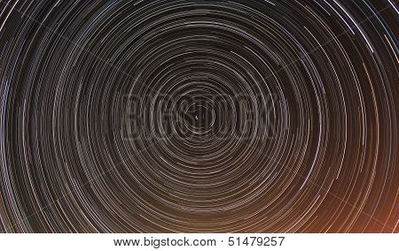 Cumulative time lapse of star trails in night sky. poster