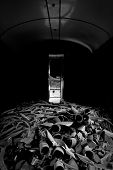 Scrap metal piled up in a room poster
