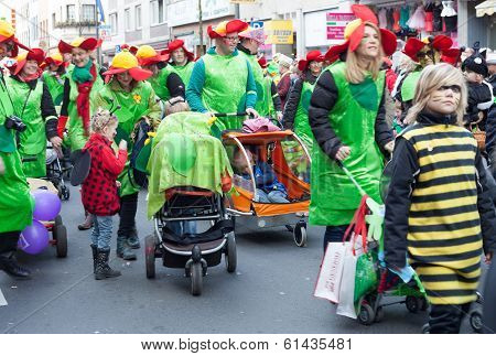 Group Of Women, Children And Men Walking In Carnival Parade