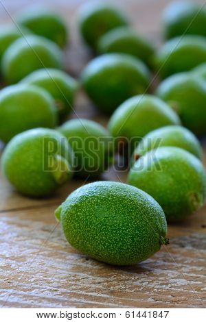 Unripe Walnuts On Table