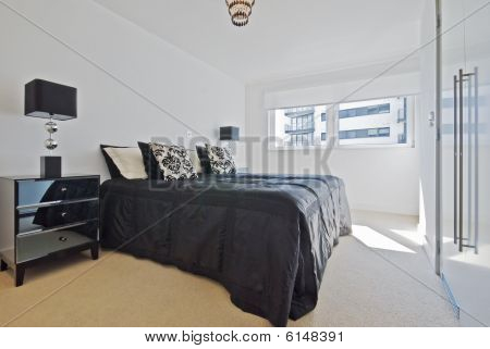 modern double bedroom with built in wardrobe