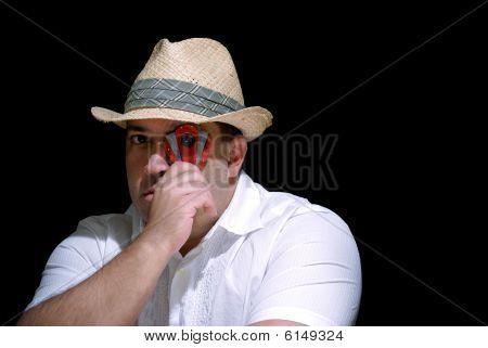 Cigar Smoker Looking Through Cutter