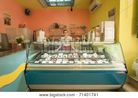 DUBROVNIK, CROATIA - MAY 26, 2014: Dolca vita ice cream parlour with friendly waitress