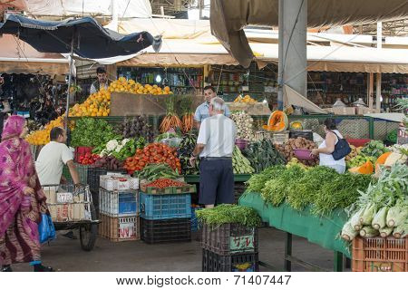 AGADIR, MOROCCO - AUGUST 28: Sellers offer fruit and vegetables in the Suk - city market  on 28 August 2014 in Agadir, Marocco