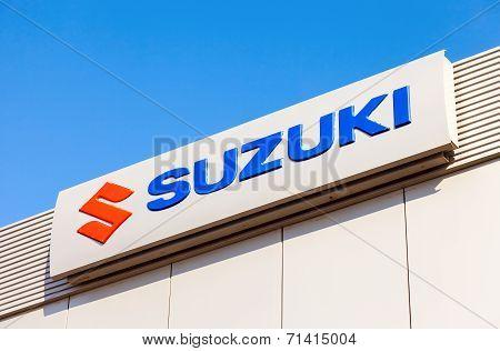 Samara, Russia - August 30, 2014: Suzuki Dealership Sign Against Blue Sky. Suzuki Motor Corporation