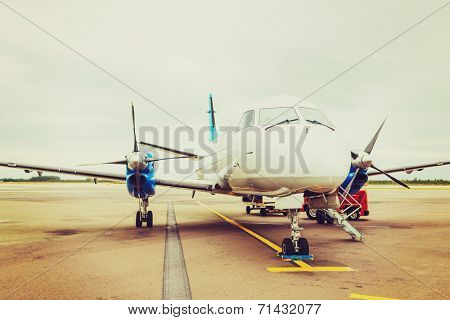 plane, airport, tourism and transportation concept - plane on runway at airport