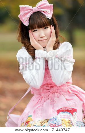 Portrait of a japanese woman in sweet lolita cosplay fashion