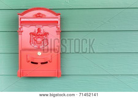 Red Mailbox With Green Wood Background