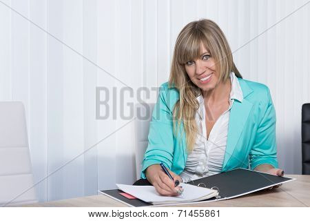 Smiling Woman Is Writing Into A File