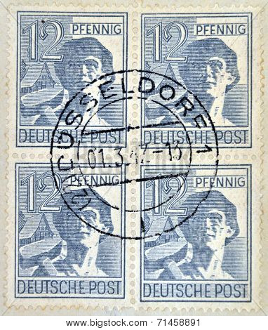 GERMANY- CIRCA 1947: A stamp printed in West Germany (FRG) shows a Laborer in a hat circa 1947