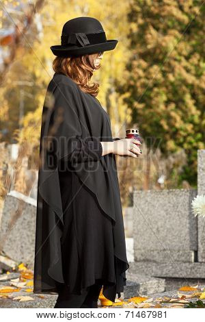 Widow At The Cemetery