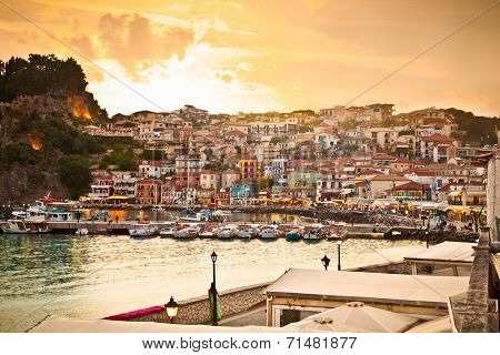 Beautiful panoramic view of Parga port and houses colors early evening, Greece.