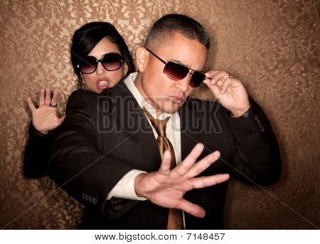 Hispanic Couple Caught In Photographer Flash