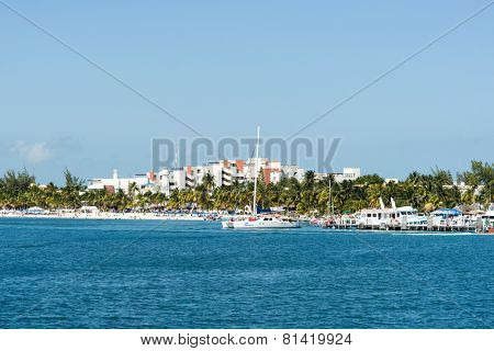 ISLA MUJERES - JANUARY 21: Tourists enjoy the sunny weather and relaxing on the beach on 21 January 2015 in Isla Mujeres, Mexico. The island is located 8 miles east of Cancun in the Gulf of Mexico.