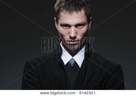 Serious Man Over Dark Background