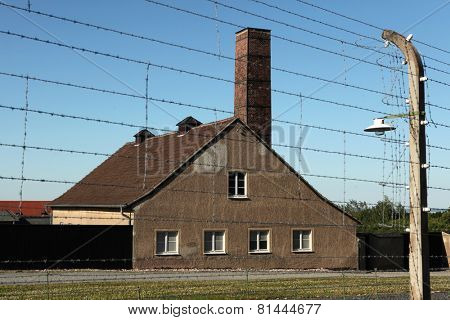 WEIMAR, GERMANY - JUNE 21, 2013: Crematorium and electrified barbed wires in the Buchenwald concentration camp near Weimar, Germany.