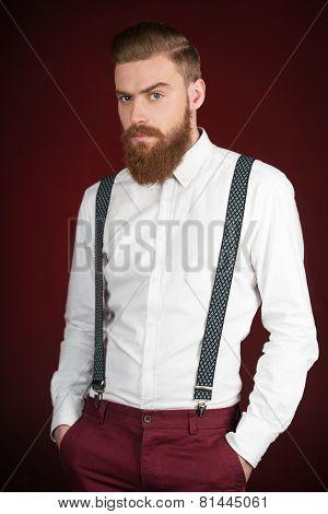 Man with beard looking at camera