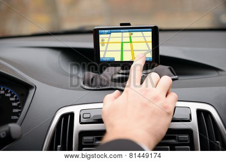 Man Using Gps Navigation While Driving