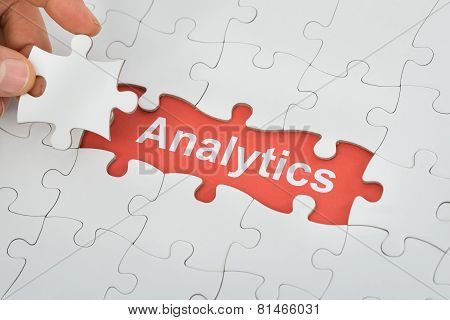 Person Holding Jig Saw Piece With Analytics Text Under Puzzle