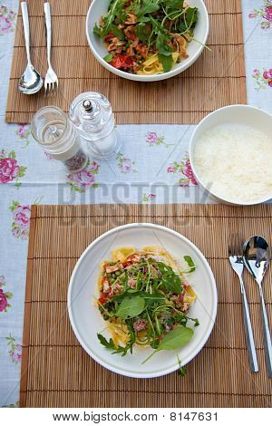 Delicious meal of pasta with fettucini rocket and tomatoes poster