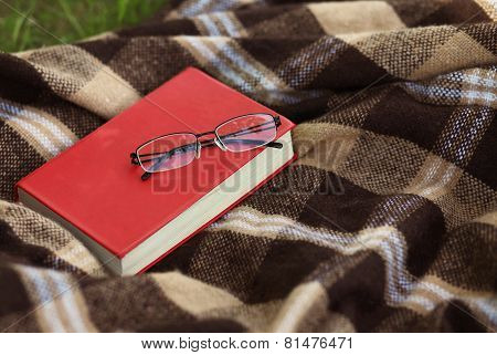 Book And Glasses On The Plaid, Reading, Education - Concept