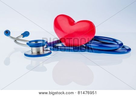 a heart and a stethoscope are adjacent. symbolic photo for heart disease and heartache