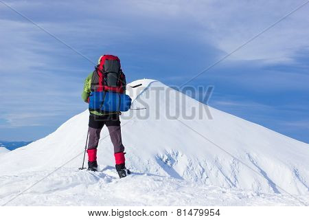 Winter hiking in the mountains .