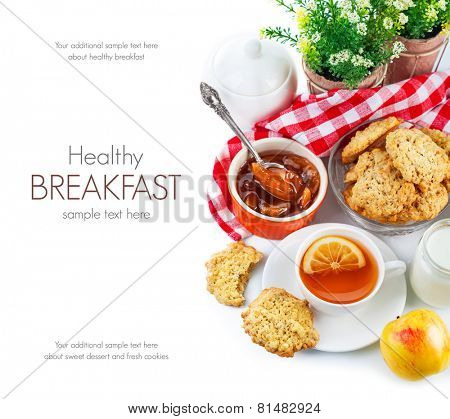Breakfast with tea and fresh cookies. Isolated on white background