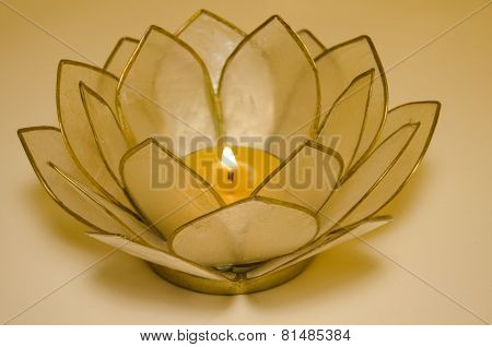 candle in lotus holder