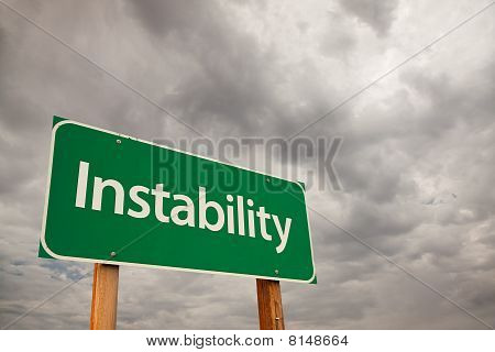 Instability Green Road Sign Over Storm Clouds
