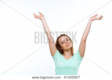 Pretty lady with closed eyes holding hands up