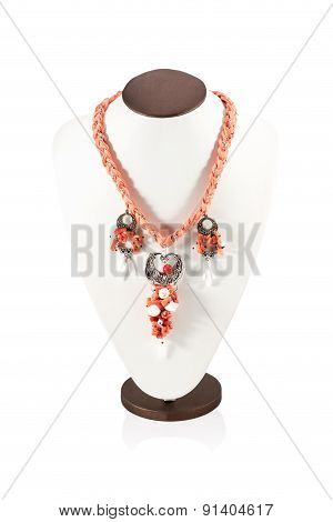 Orange necklace handmade on bust for display isolated on a white background poster