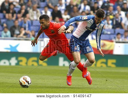 BARCELONA - APRIL, 25: Dani Alves(L) of FC Barcelona fights with Victor Alvarez(R) of Espanyol during a Spanish League match at the Power8 stadium on April 25, 2015 in Barcelona, Spain