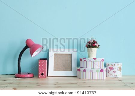 Interior detail. Home shelf with shabby chic decor on it over blue wall