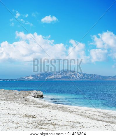 Stintino Shoreline Under A Blue Sky With Clouds