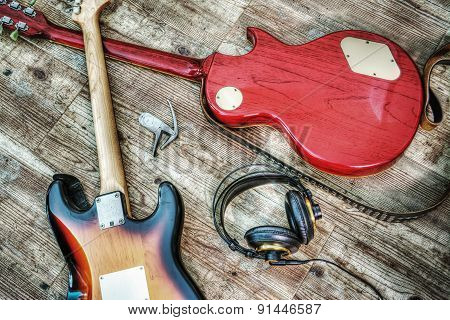 Two Electric Guitars And Headphones In Hdr