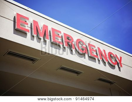 the front entrance sign to an emergency room department in a city hospital