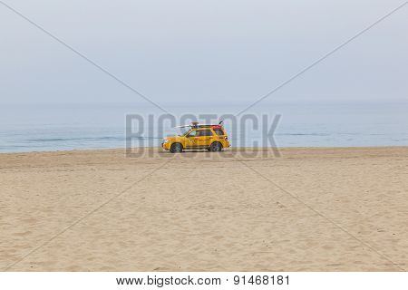 Life Guard Cars Patrol At The Beach