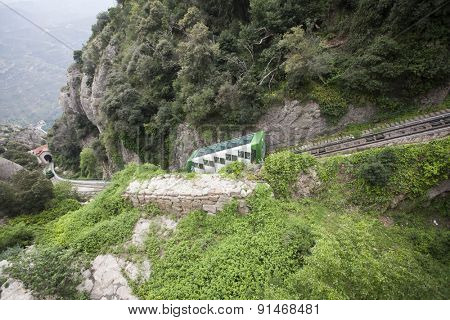 MONTSERRAT, SPAIN - MAY 04, 2015: Rack railway train departing Montserrat Cremallera station near monastery on MaY 04, 2015 in Montserrat, Spain.