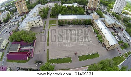RUSSIA, MOSCOW - MAY 16, 2014: Plateau near barracks of military units garrison of internal troops of Ministry of Home Affairs of Russian Federation at sunny day. Aerial view.