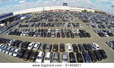 RUSSIA, MOSCOW - MAY 14, 2014: Lot of vehicles on parking for new car of Avtoframos company at spring sunny day. Aerial view