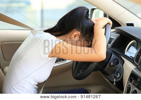 sad woman driver in car