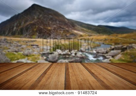Landscape Over Waterfall Towards Pen-yr-ole-wen Mountain In Snowdonia With Wooden Planks Floor