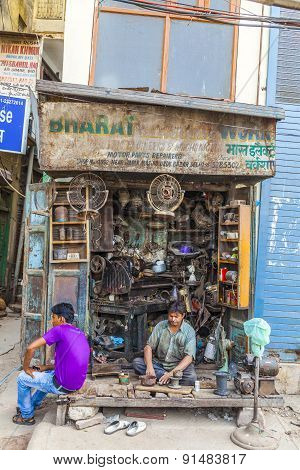 Owner Of A Car Sparepart Shop Waits For Customer