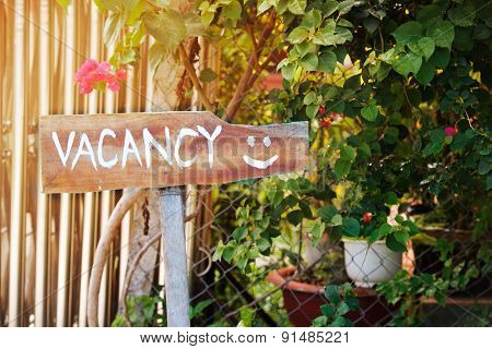 Outdoor pointer with the vacancy word and smile poster