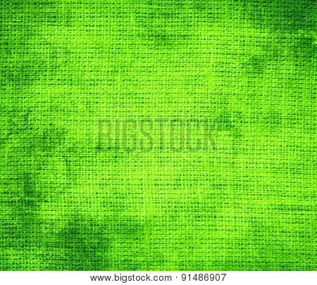 Grunge background of chartreuse (web) burlap texture